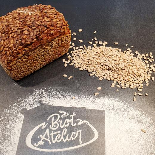 Dinkel Hafer Vollkornbrot mit Sonnenblumenkernen | Das Brot-Atelier Gießen